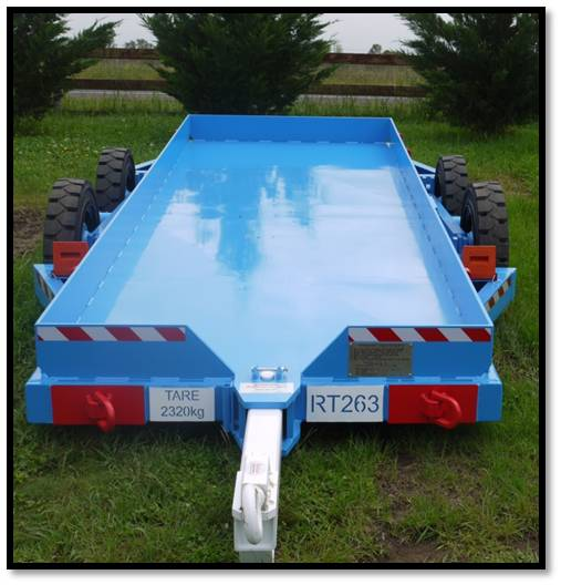 Cable bolt trailer for underground mines