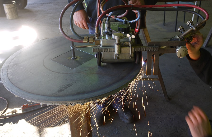 Chamfering side plates for cable drum